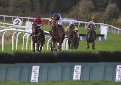 Inish Island (right) heads Moyas Charm going to the last in the second at Downpatrick