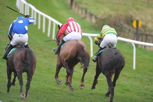 Urban Gale (nearside), Rookery Rebel (centre) & Clancy Strand (green & gold) battle it out