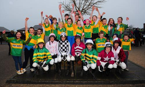 Children from the local Ballymore Eustace Football Club with jockeys at Punchestown