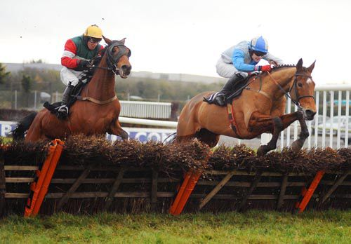 Rating Queen & Kevin Sexton (right) jumps the last ahead of High Class Show