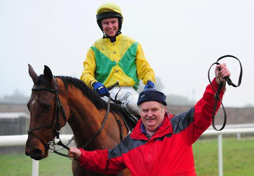 The father and son team of trainer Sean and jockey Noel after the success of Drumlee in the last