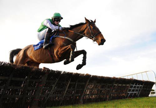 King Of Firth & Danny Mullins jump a hurdle on their way to victory