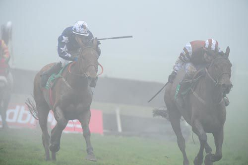 Rich Revival (right) pictured on his way to victory at a foggy Navan earlier this month
