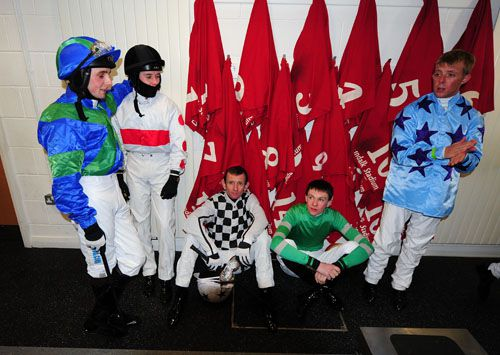 Jockeys wait in the weighroom as the first race is delayed