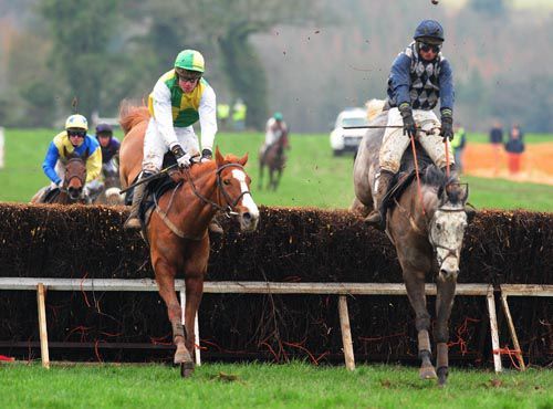 Eventual winner Down Ace & Derek O'Connor (left) jumps the last alongside Just A Tick & Jamie Codd