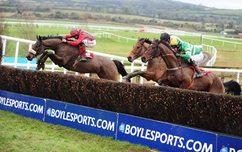 Lastoftheleaders (left) and Davy Russell lead over the last