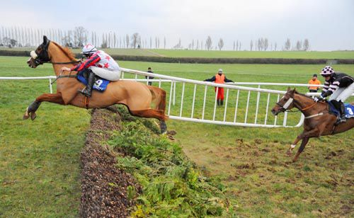Tipped Up Harry and Adrian Heskin jumping ahead of Dazzlers Day