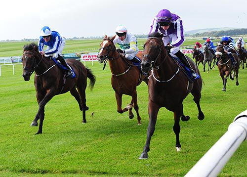 Guerre, right, beats Atlantic Sea, left, and Diamond Stilettos at the Curragh